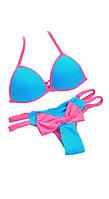 Голубой купальник с розовым бантом