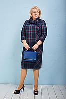 Стильое платье  выполнено в деловом стиле