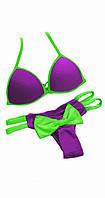 Фиолетовый купальник с салатовым бантом