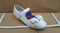 Белые нарядные туфли на девочку