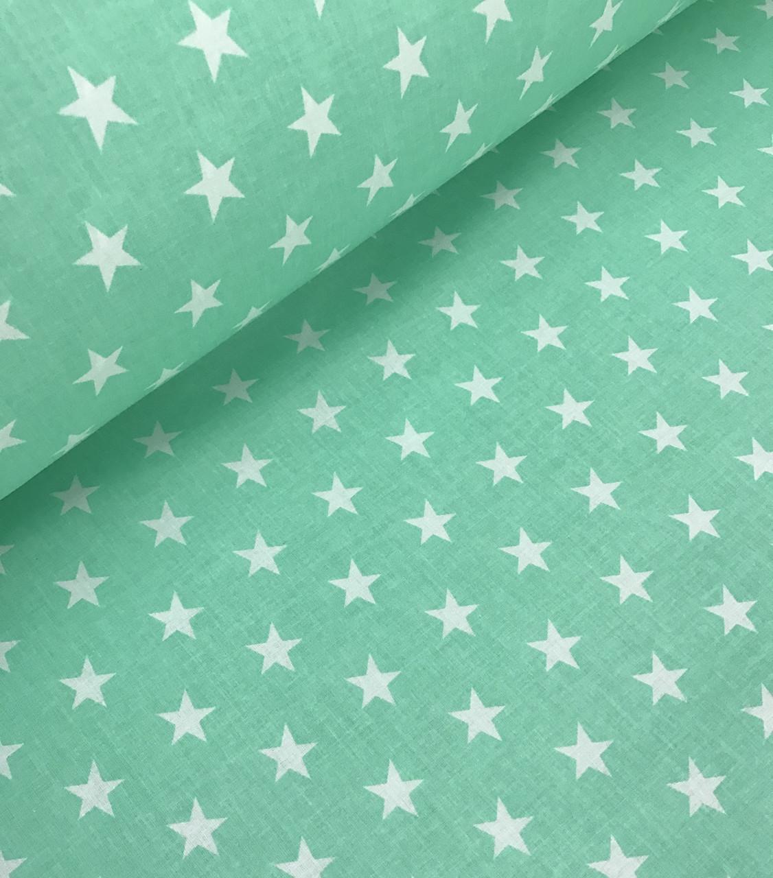 Хлопковая ткань польская белые звезды частые на светло-мятном