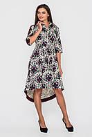 Бежево-сиреневое платье приталенного силуэта