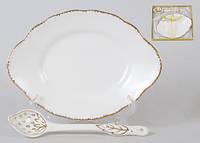 Набор: овальная тарелочка с десертной ложкой, 15см