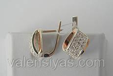 Женские серебряные серьги оригинальной формы с фианитами
