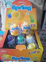Пластиковое яйцо с сюрпризомb и конфетой Spring