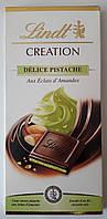 """Шоколад черный Lindt """"Delice Pistache, Aux Eclats d`Amandes"""", 150 г"""