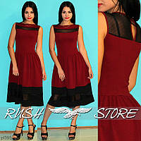 Расклешенное платье со вставкой из сетки