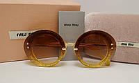 Солнцезащитные очки Miu Miu SMU 55 R Золото