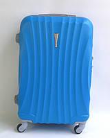 Чемодан дорожный пластиковый на колесах: средний, голубой - волнистый