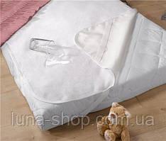 Непромокаемая махровая простынь в кроватку на резинках 120х60