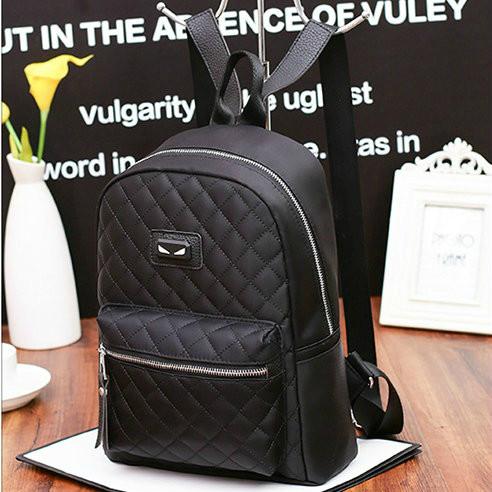 Молодежный стеганый рюкзак черного цвета