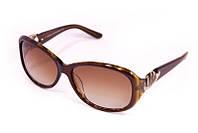 Солнцезащитные женские очки коричневого цвета
