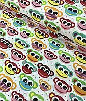 Хлопковая ткань польская обезьянки красно-желто-зеленые на белом