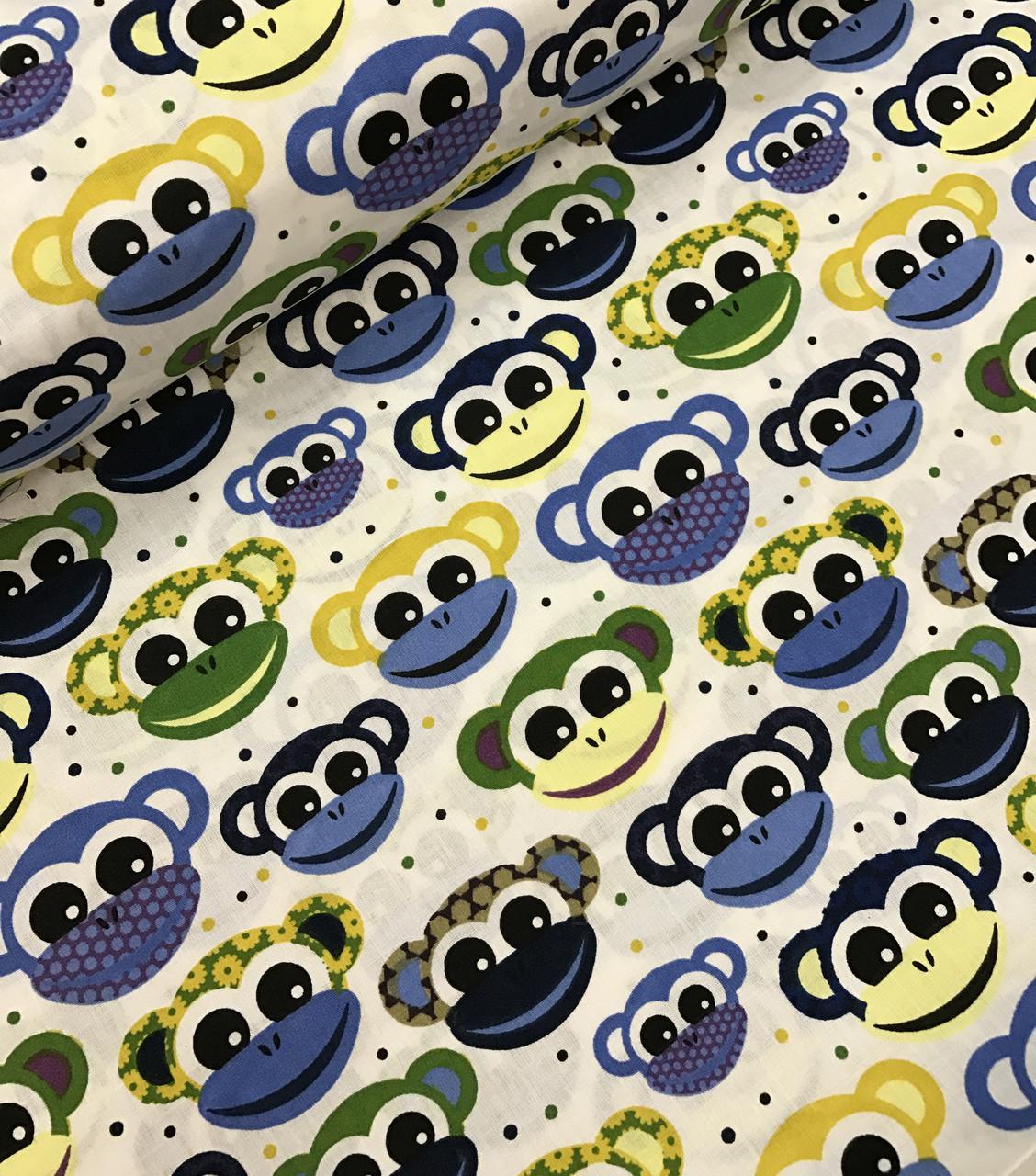 Хлопковая ткань польская обезьянки сине-желто-зеленые на белом