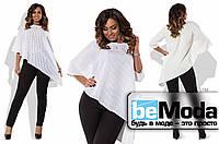 Эффектный женский костюм большого размера из ассиметричной блузы и облегающих брюк черно-белый