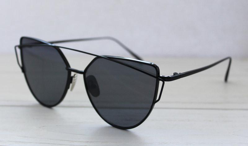 Женские солнцезащитные очки необычной формы