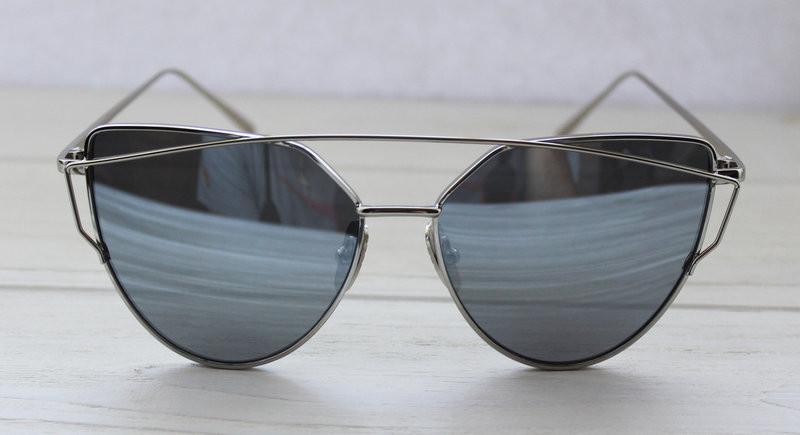 Женские солнцезащитные очки необычной формы с зеркальными линзами