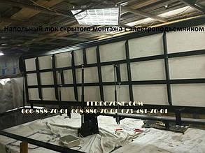 Напольный люк скрытого монтажа Revizio с электроподъемником 1