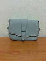 Молодежная сумочка-клатч серого цвета