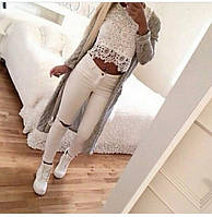 Хит сезона! Белые джинсы с прорезями на коленях