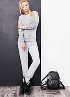 Женский спортивный костюм с шнуровкой на рукавах. Материал двух нитка. Размер SM, ML