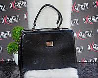 Оригинальная черная сумка-саквояж.