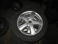 Б/у Диск литой с шиной R15 Ford Fiesta