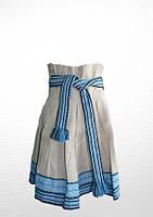 Спідниця вишита на дівчинку, сірого кольору з голубою вишивкою.