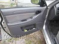 Обшивка дверная передняя левая Люкс без ручки Lanos / Ланос, 96277225