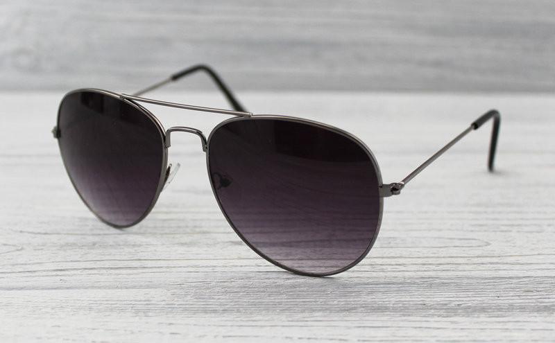 Женские фигурные солнцезащитные очки с тонкими дужками