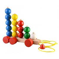 Детская  деревянная игрушка  каталка  Пирамидки-считаем  шарики .