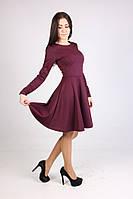 Молодежное платье из трикотажа с расклешенной юбкой