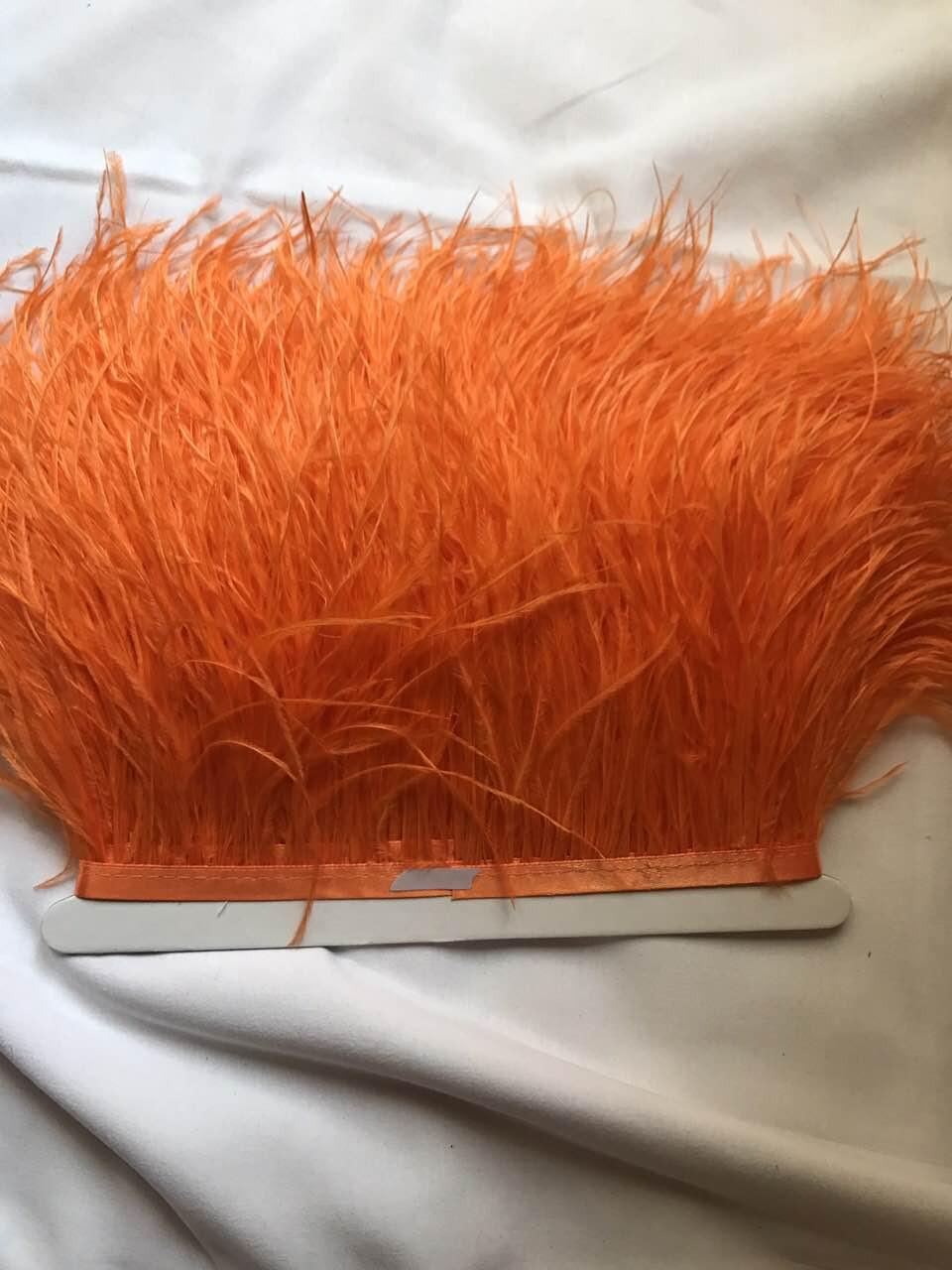 Перьевая тесьма из перьев страуса .Цвет оранжевый.Цена за 0,5м