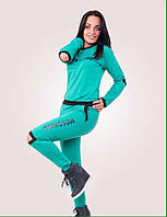 Спортивный костюм женский с разрезами на локтях и коленях, лого Москино
