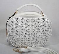 Модная округлая женская практичная сумочка-клатч с перфорацией