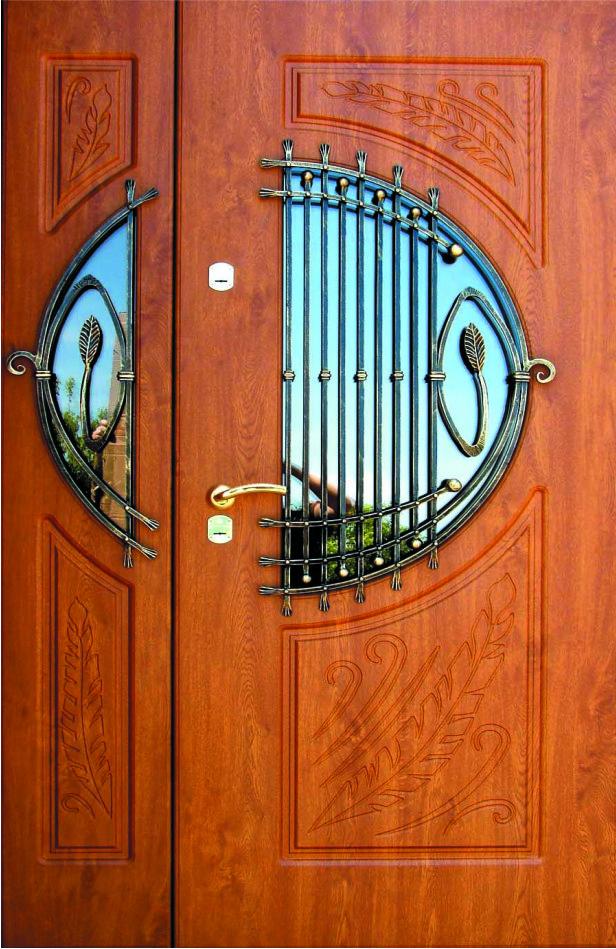 Двери входные полуторка с ковкой, резьбой