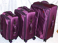 Набор чемоданов фуксия на 4х колесах 3 шт THREE BIRDS (28х24х20)