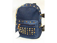 Джинсовый рюкзак синего цвета с шипами