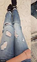 Стильные облегающие женские джинсы с прорезями и потертостями на болтах посадка средняя Турция
