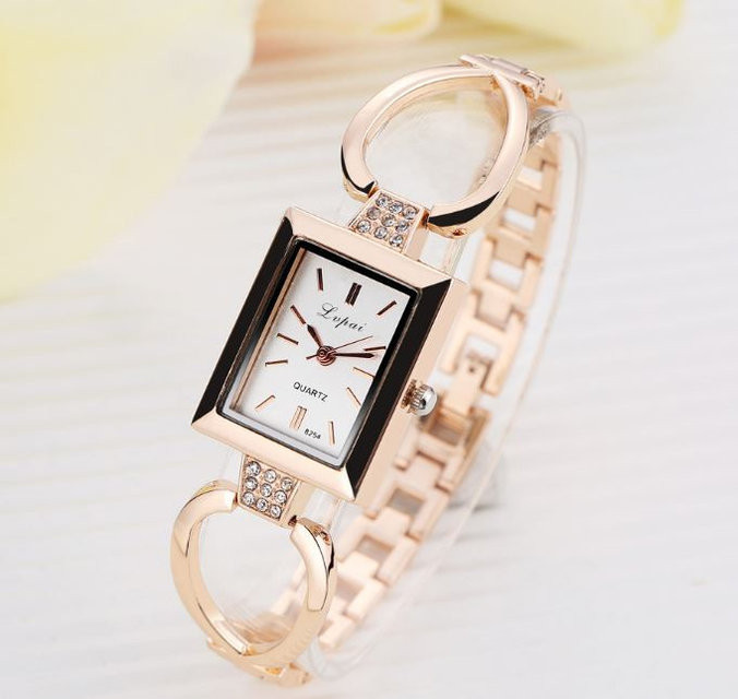 Женские часы золотистые