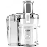 Соковыжималка JE1200 Zelmer, имеет мощность 500 Вт, 2 скорости и подачу сока с отделителем пены и емкостью 0,