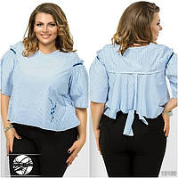 Стильная рубашка асимметричной длины с рукавами-колокол, декорирована нашивкой. Сзади клешеная с завязками.