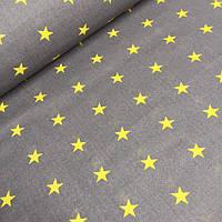 Польская бязь желтые звезды на средне-сером фоне  №555