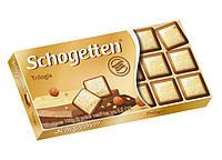 Шоколад молочно-белый Schogеtten Trilogia с лесным орехом 100 г.