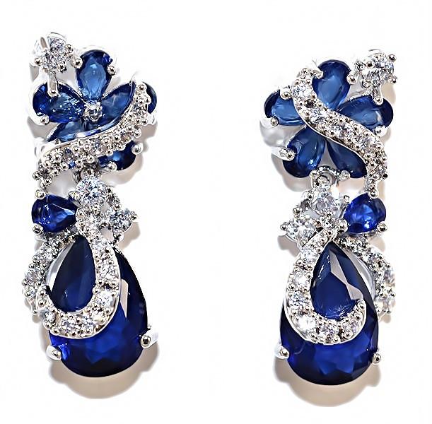 Серьги вечерние.Камень: белый и синий циркон. Высота серьги: 2,7 см. Ширина: 10 мм.