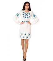 Плаття вишите жіноче, білого кольору з синьою вишивкою, на довгий рукав.