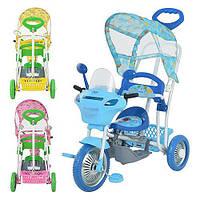Трехколесный велосипед, имеет качалку, крышу, снабжен ручкой для родителей