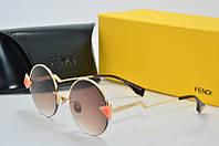 Солнцезащитные очки Fendi круглые коричневые