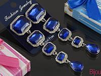 Длинные вечерние серьги  под серебро с синими кристаллами