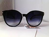 Стильные очки с черными линзами